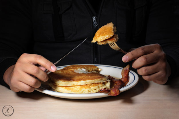 Stock Photography, first bite of pancake, breakfast, pancakes and bacon, restaurant food, man eating breakfast, man eating pancakes