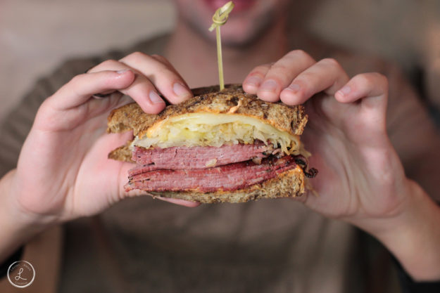 Stock Photography, first bite of reuben sandwich, lunch time, reuben sandwich, restaurant food, man eating lunch, man eating reuben sandwich, meal time