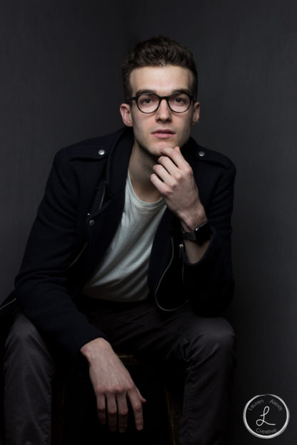 Mens fashion portrait, mens portrait, thinking man, model with glasses, navy coat